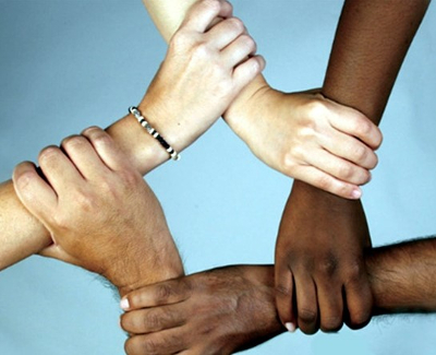 People holding hands forming a circle